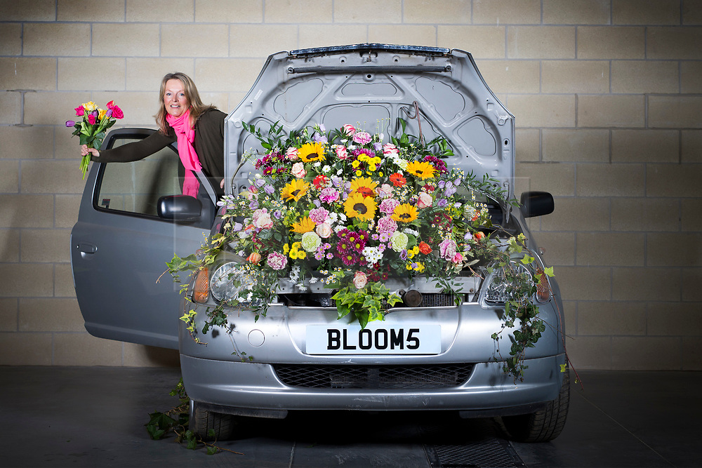 © Licensed to London News Pictures. 20/03/2017. Harrogate, UK. Fiona Fisk with the first of the Floral Bonnets car's to arrive at the Yorkshire Show ground for the Harrogate Flower Show. Floral Bonnets is part of the show's spring theme & has seen Floristry students from across Yorkshire challenged to create a floral display using real cars. The Harrogate Flower Show is the UK's largest exhibition of floral art & this years spring theme HortCouture will see a series of new features celebrating style trends in the home, garden & wardrobe. Photo credit: Andrew McCaren/LNP