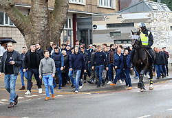 Police on horseback surround fans prior to the match