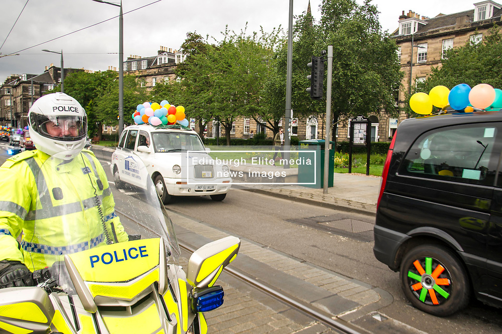 Pictured: <br /> <br /> There were np prisoners taken when the Edinburgh Taxi Drivers annual charity trip headin g towards Princes Street with Transport minister Humza Yousaf and policeman making great targets for the water bombs and water pistols carried by the young passengers.<br /> <br /> Ger Harley   EEm 13 June 2017