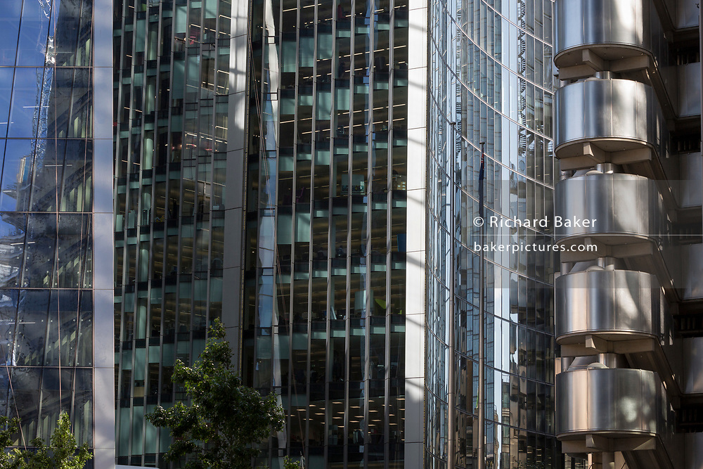 Financial services and insurance company office architecture in the City of London, the capital's historic financial district, on 2nd August 2018, in London, England.