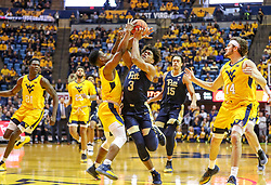 Dec 8, 2018; Morgantown, WV, USA; Pittsburgh Panthers guard Malik Ellison (3) drives down the lane defended by West Virginia Mountaineers guard Brandon Knapper (2) during the first half at WVU Coliseum. Mandatory Credit: Ben Queen-USA TODAY Sports