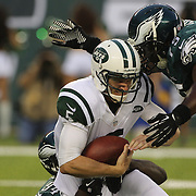 Jets quarterback Matt Simms is sacked by Chris McCoy, (left) and Vinny Curry in first quarter action during the New York Jets V Philadelphia Eagles Pre Season NFL match at MetLife Stadium, East Rutherford, NJ, USA. 29th August 2013. Photo Tim Clayton