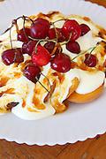 Peach Melba (Icecream and peaches with a liqueur) with cherries