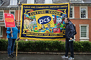 Members of the PCS Culture Group hold a banner at a picket outside the Old Police House in Hyde Park by Royal Parks workers outsourced via French multinational VINCI Facilities as part of joint strike action by the United Voices of the World UVW and Public and Commercial Services PCS trade unions on 30th July 2021 in London, United Kingdom. The joint strike, with members dual carding over pay, conditions and the sacking of a member of staff, is believed to be the first between a TUC and a non-TUC trade union and follows the launch of a legal challenge by the Royal Parks workers against indirect racial discrimination by the Royal Parks.