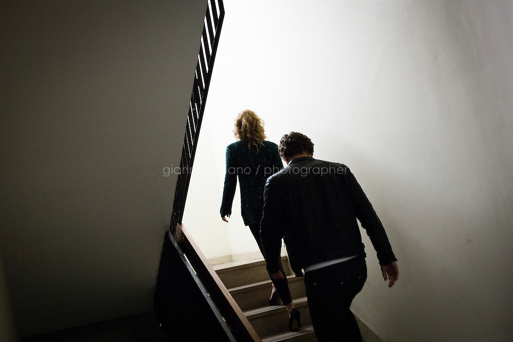 """TURIN, ITALY - 23 October 2013: (L-R) Participants of talent show Masterpiece Federica Lauto (29) and Alessandro Ligi (49) walk up the stairs towards the studio to record the first episode of the show at the RAI national TV headquarters, in Turin, Italy, on October 23rd 2013.<br /> <br /> Masterpiece is the first talent show for aspiring writers, produced by Rai and FremantleMedia.  The show's objective is to find new talents in Italian literature. 4,919 manuscripts were sent to the program and 80 have been selected for the final selections that will be broadcasted from the Masterpiece studio at the RAI headquarters of Turin starting November 17th on Rai3 national TV. The winner will have his novel co-distributed by RCS and Bompiani, two Italian publishers. <br /> <br /> The jury is composed of Andrea De Carlo (a Milan based author of 17 novels among which is """"Due di due""""), Giancarlo De Cataldo (magistrate, screenwriter and author of """"Romanzo Criminale"""") and Taiye Selasi, author of TBK."""