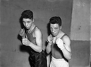 Private T Butler (2nd Battalion) (Corinthians) at National Junior Boxing Championships, Featherweight Winner (on right).<br /> On left F. Teidt, Featherweight runner up.<br /> 18/12/1952