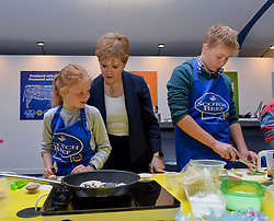 Pictured: First Minister Nicola Sturgeon meets children cooking pork stir fry at the show.<br /> <br /> Scotland's First Minister Nicola Sturgeon joined thousands of visitors attending day 2 of the 2019 Royal Highland Show at Ingliston.<br /> <br /> © Dave Johnston / EEm