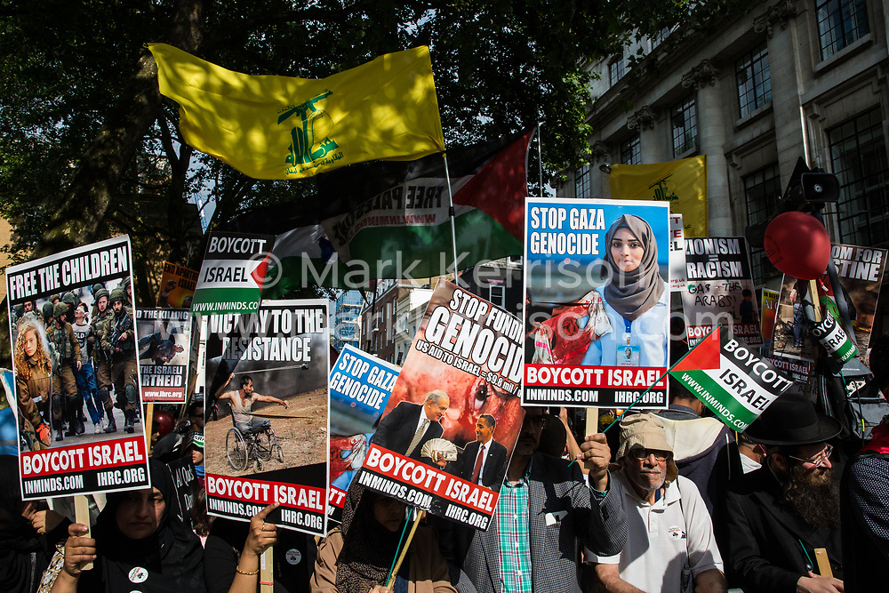 London, UK. 10th June, 2018. Hundreds of people wait with placards and Hezbollah flags outside the Saudi embassy to take part in the pro-Palestinian Al Quds Day march through central London organised by the Islamic Human Rights Commission. An international event, it began in Iran in 1979. Quds is the Arabic name for Jerusalem.