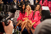 11/9/11 12:47:29 PM -- New York, NY, U.S.A<br />  -- Victoria's Secret 2011 NYC Fashion Show. -- <br /> Models pose for photographers before the start of the  2011Victoria's Secret Fashion Show at the Lexington Armory in New York, Wednesday, November 9, 2011. Pictured from left to right are Lais Ribeiro, Candace Swanepoel, and Alessandra Ambrosio.<br /> <br /> <br /> Photo by Emile Wamsteker, Freelance