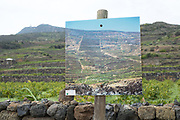 A photographic display at Donnafugata shows the terraced landscape of Pantelleria from the 1960s, contrasted with the current landscape.