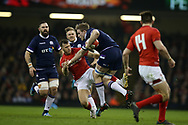 Jonny Gray of Scotland breaks away from a tackle from Gareth Davies of Wales. Wales v Scotland, NatWest 6 nations 2018 championship match at the Principality Stadium in Cardiff , South Wales on Saturday 3rd February 2018.<br /> pic by Andrew Orchard, Andrew Orchard sports photography