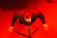20 NOV 2001, NUERNBERG/GERMANY:<br /> Gerhard Schroeder, SPD Parteivorsitzender und Bundeskanzler, waehrend einer kurzen rede vor dem Parteiabend des SPD Bundesparteitag von steil oben auf einer rot eingeleuchteten Buehne fotografiert, Congress Centrum Nuernberg<br /> IMAGE: 20011119-01-035<br /> KEYWORDS: Parteitag, Nürnberg, Gerhard Schroeder,