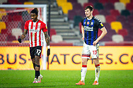 Brentford forward Ivan Toney (17) and Middlesbrough midfielder Paddy McNair (17) during the EFL Sky Bet Championship match between Brentford and Middlesbrough at Brentford Community Stadium, Brentford, England on 7 November 2020.