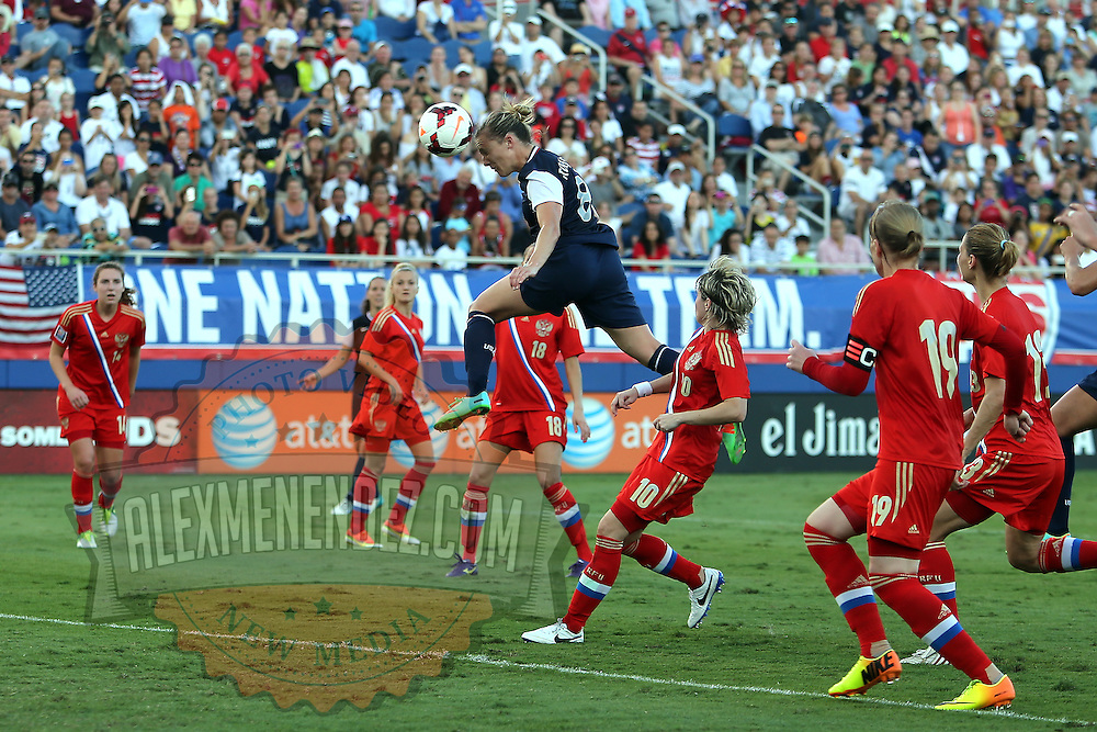 U.S. Forward Amy Rodriguez (8) heads the soccer ball during an international friendly soccer match between the United States Women's National soccer team and the Russia National soccer team at FAU Stadium on Saturday, February 8, in Boca Raton, Florida. (AP Photo/Alex Menendez)