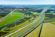 Nederland, Gelderland, Gemeente Neder-Betuwe, 30-09-2015; goederentrein passeert rivier de Linge onderweg van Duitsland naar de Haven van Rotterdam op de Betuweroute. Omgeving Ochten, de autosnelweg A15 loopt parallell aan de spoorlijn.<br /> Freight train en route from Germany to the Port of Rotterdam on the Betuweroute.  A15 motorway runs parallell to the railroad.<br /> luchtfoto (toeslag op standard tarieven);<br /> aerial photo (additional fee required);<br /> copyright foto/photo Siebe Swart