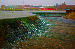 13 October 2014:   Autumn on a very rainy day in McLean County.  Lake Bloomington Spillway.<br /> <br /> This image was produced in part utilizing High Dynamic Range (HDR) or panoramic stitching or other computer software manipulation processes. It should not be used editorially without being listed as an illustration or with a disclaimer. It may or may not be an accurate representation of the scene as originally photographed and the finished image is the creation of the photographer.