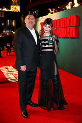 Graham King and guest attending the Tomb Raider European Premiere held at Vue West End in Leicester Square, London