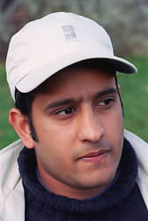 Portrait of young man wearing baseball cap looking thoughtful,
