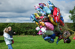 © Licensed to London News Pictures.29/07/15<br /> Borrowby, UK. <br /> <br /> A woman and child look at the balloons offered for sale at the Borrowby Country Show and Gymkhana in North Yorkshire.<br /> <br /> Photo credit : Ian Forsyth/LNP