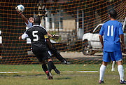 Deportivo Colomex Goalie Jose Cormona attempts to defend against what would be the only goal scored by Team Shlama F.C. during National Soccer League play in Skokie, Il.
