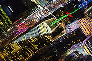 Aerial view of the Bank of America building at Bryant Park in New York City at night, photographed from a helicopter.