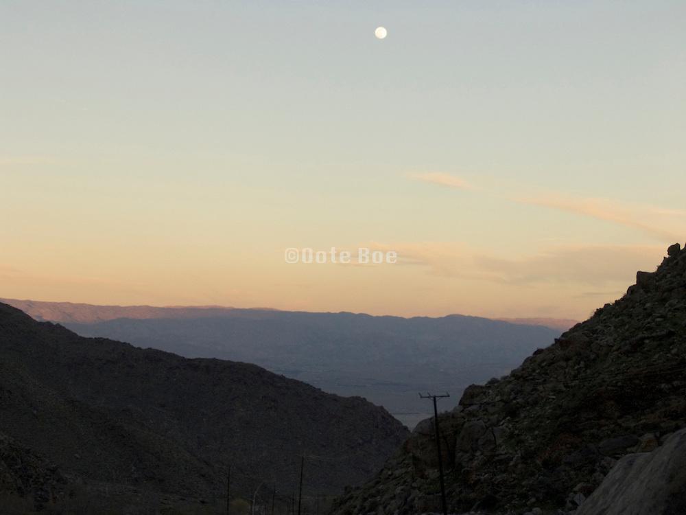 mountain range with moon at sunset USA