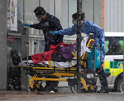 © Licensed to London News Pictures.09/02/2021, London,UK. A patient arrives at the Royal London Hospital in east London during a snow shower, as the third national lockdown continues and hospitals are struggling to cope with the number of admissions. Photo credit: Marcin Nowak/LNP