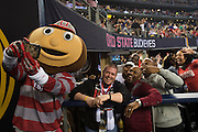 Buckee the Buckeye takes a selfie with fans during the College Football Playoff National Championship Game at AT&T Stadium on January 12, 2015 in Arlington, Texas.  (Cooper Neill for The New York Times)
