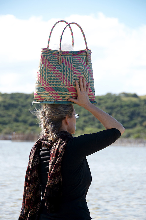 Frances Potter of The New Basket Workshop crosses a lake at Kosi Bay to reach one of the iSimangaliso craft program groups