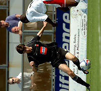 Photo: Ian Hebden.<br />Milton Keynes Dons v Hartlepool United. Coca Cola League 2. 09/09/2006.<br />Hartlepools James Brown (L) takes on MK Dons Drissa Diallo (R).
