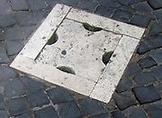 Decorative detail from the area surrounding Castel Sant'Angelo and the Ponte Sant'Angelo in Rome, Italy. Many decorative sculptural and architectural details adorn the length of the bridge, as well as the area surrounding it and the Castel Sant'Angelo. This image shows decorative floor emblem.