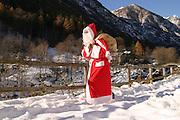 Santa Christmas brings gifts in the snow