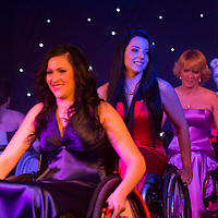Girls perform on the catwalk during the Miss Colours International wheelchair beauty contest in Budapest, Hungary on March 22, 2014. ATTILA VOLGYI