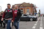 Fans leaving Upton Park Station for Boleyn Ground. scenes around the Boleyn Ground, Upton Park in East London as West Ham United play their last ever game at the famous ground before their move to the Olympic Stadium next season. Barclays Premier league match, West Ham Utd v Man Utd at the Boleyn Ground in London on Tuesday 10th May 2016.<br /> pic by John Patrick Fletcher, Andrew Orchard sports photography.