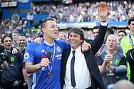 Chelsea Captain John Terry (L) & Chelsea Head Coach Antonio Conte (R) celebrate after the game. Premier league match, Chelsea v Sunderland at Stamford Bridge in London on Sunday 21st May 2017.<br /> pic by Steffan Bowen,  Andrew Orchard sports photography.