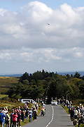 UK, September 15 2011: The race helicopter hovers in the sky as spectators wait for the race to arrive on Haytor during the fifth stage of the 2011 Tour of Britain. The stage started in Exeter and finished in Exmouth. Copyright 2011 Peter Horrell