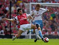 Photo: Daniel Hambury.<br />Arsenal v Aston Villa. The Barclays Premiership. 19/08/2006.<br />Arsenal's Francesc Fabregas tackles Villa's Steven Davis.