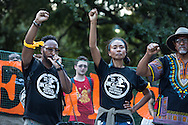 """Protesters who took part in the """"Take em down march"""", return to Congo Square after marching to Jackson Square where they had hoped to topple a sculpture of Andrew Jackson but were unable to due a police presence that blocked them from getting close to the sculpture."""