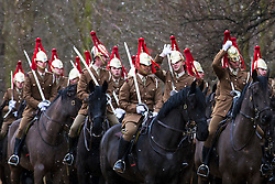 © Licensed to London News Pictures. 26/02/2018. London, UK. The Household Cavalry train in Hyde Park as snow falls. Severe cold, blizzards and heavy snow are expected as the 'Beast from the East' brings freezing Siberian air to the UK. Photo credit: Rob Pinney/LNP