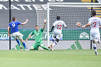 LEICESTER, ENGLAND - JULY 04: Jamie Vardy of Leicester City places the ball past Crystal Palace goalkeeper Vicente Guaita to score his second goal and his sides third during the Premier League match between Leicester City and Crystal Palace at The King Power Stadium on July 4, 2020 in Leicester, United Kingdom. Football Stadiums around Europe remain empty due to the Coronavirus Pandemic as Government social distancing laws prohibit fans inside venues resulting in all fixtures being played behind closed doors. (Photo by MB Media)