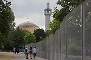 Regents Park Mosque and the temporary perimeter fence encircling Winfield House, the official residence of the US Ambassador during the visit to the UK of US President, Donald Trump, on 12th July 2018, in Regents Park, London, England.