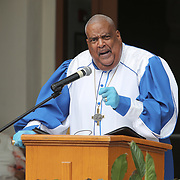 Reverend Dr. James T. Morris of Carter Tabernacle CME Church holds an Easter service on Sunday, April 12, 2020 in Orlando, Florida. The church invited parishioners to drive up and stay in their cars or to watch via internet streaming due to the Coronavirus (Covid-19) outbreak and social distancing rules. (Alex Menendez via AP)