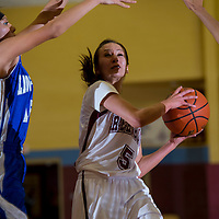 120913   Brian LEddy<br /> Rehoboth Lynx Tanya Watchman (5) drives towards the hoop during Monday's game against Laguna-Acoma at Rehoboth.