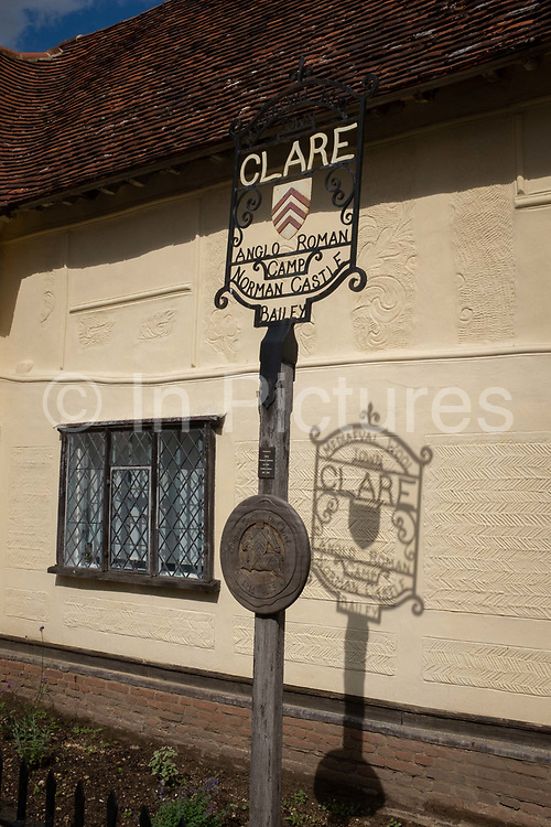 The street sign for the Suffolk wool town of Clare in rural Suffolk, on 10th July 2020, in Clare, Suffolk, England. During the medieval period Clare became a prosperous town based on cloth making. The wool trade was already present by the 13th century, steadily expanding as demand grew. 3000 local fleeces were sold from Clare Manor alone in 1345. By the 1470s Suffolk produced more cloth than any other county.