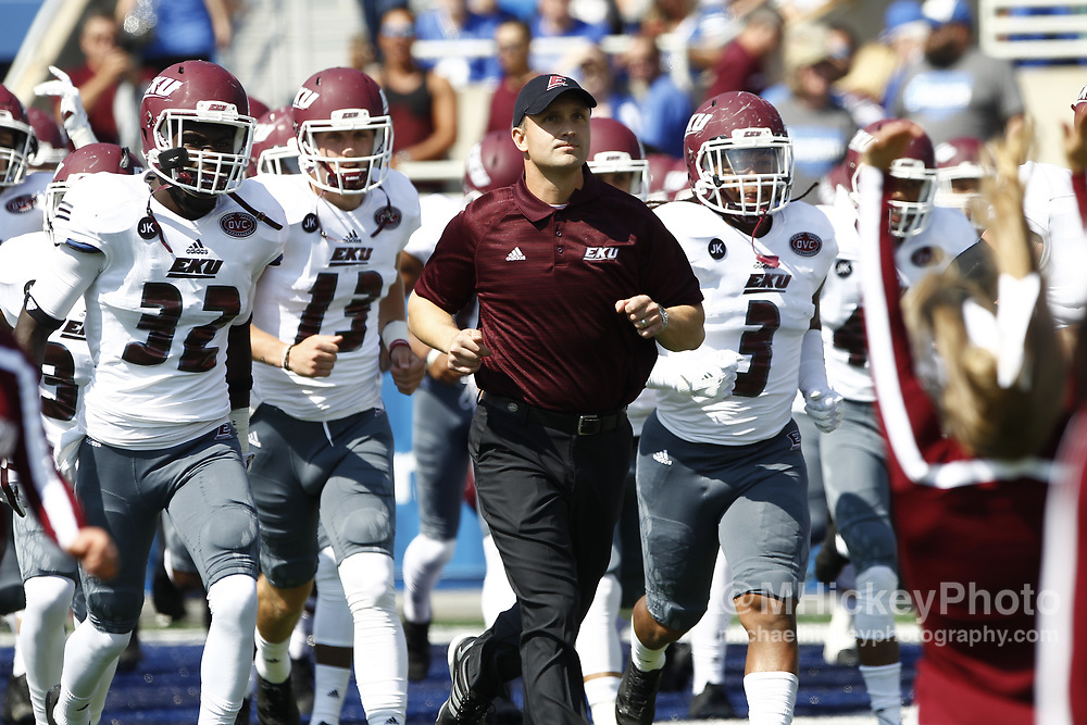 LEXINGTON, KY - SEPTEMBER 09: Head coach Mark Elder of the Eastern Kentucky Colonels leads his team onto the field before the game against the Kentucky Wildcats at Kroger Field on September 9, 2017 in Lexington, Kentucky. (Photo by Michael Hickey/Getty Images) *** Local Caption *** Mark Elder