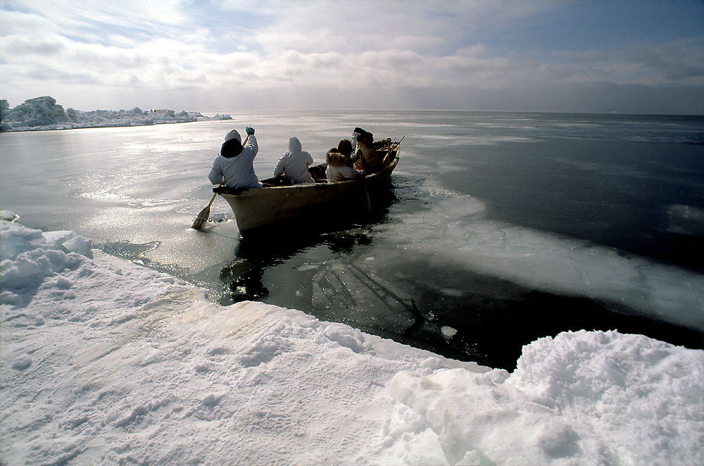 Barrow, Alaska, Native whaling crew setting off from sea ice onto the Chukchi Sea to hunt for bowhead whales