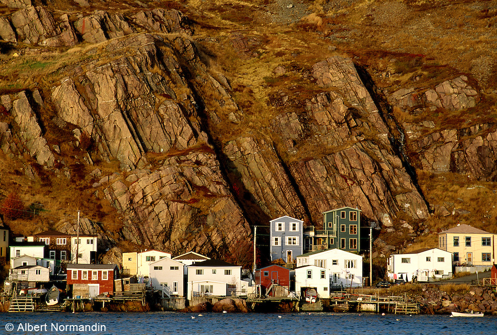 Village of Quidi Vidi and homes on waterfront with rock cliff