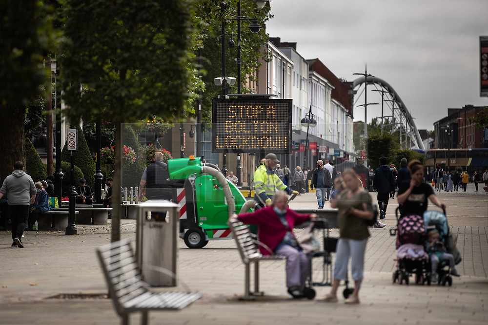 """© Licensed to London News Pictures . 16/09/2020. Bolton , UK . Sign saying """" Stop a Bolton Lockdown """" in Victoria Square in Bolton Town Centre . The number of recorded cases of Coronavirus has gone over 200 in a single day , in Bolton . Photo credit : Joel Goodman/LNP"""