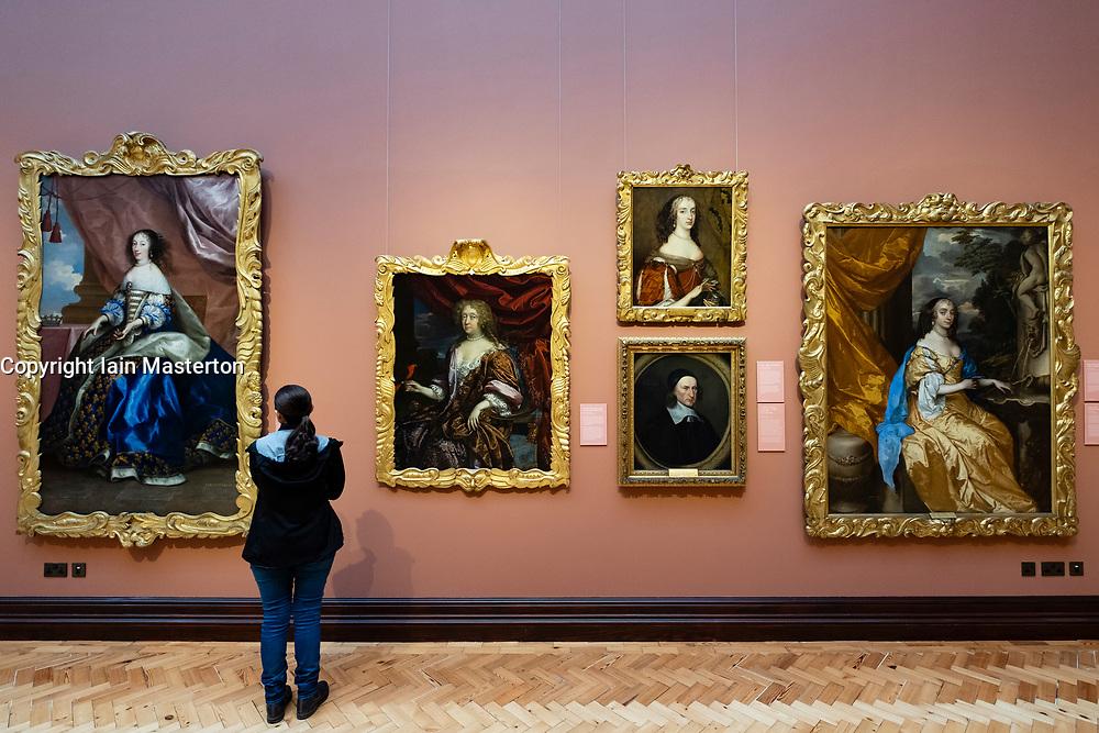 Visitor looking at paintings inside Scottish National Portrait Gallery in Edinburgh, Scotland , Uk