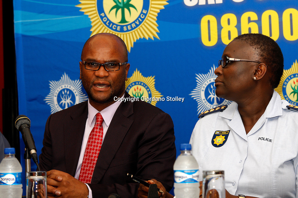 DURBAN - 7 February 2014 - National police minister Nathi Mthethwa (lef) and National Police Commissioner Riah Phiyega speak at a press conference in Durban where 1500 police station commanders attended a conference. Picture: Allied Picture Press/APP